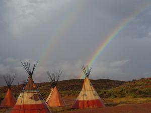 Rainbow behind PVFC tipis