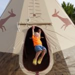 Family playing in a tipi
